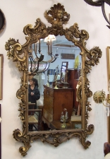 Late 18th early 19th century Continental wall mirror with angel top