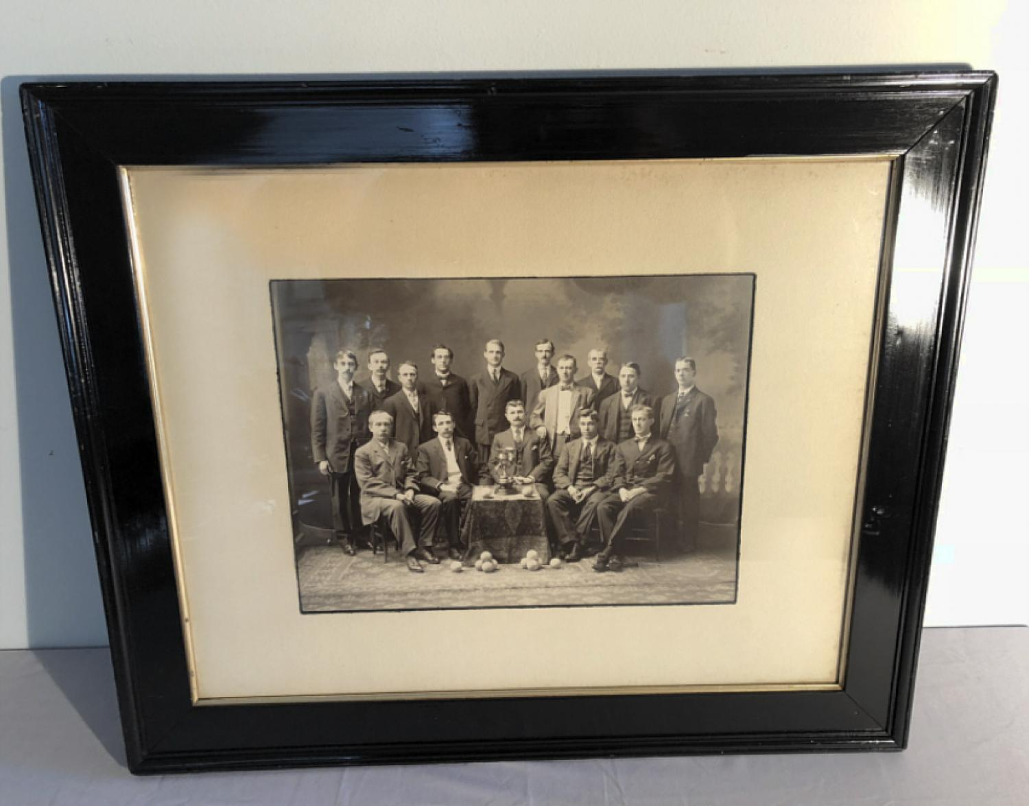 Vintage photo of carpet ball trophy and team c1900