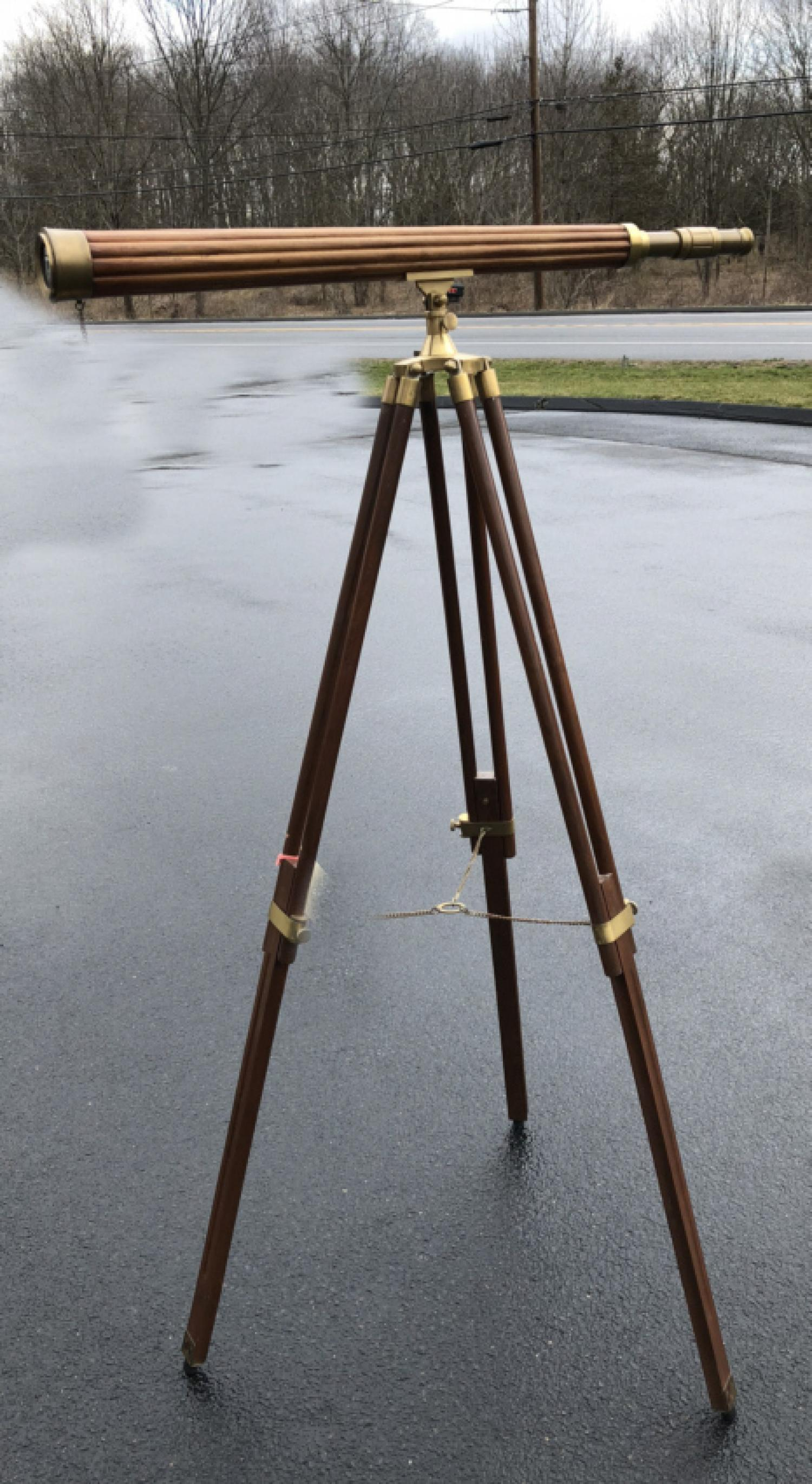 Large brass and wood telescope on tripod stand