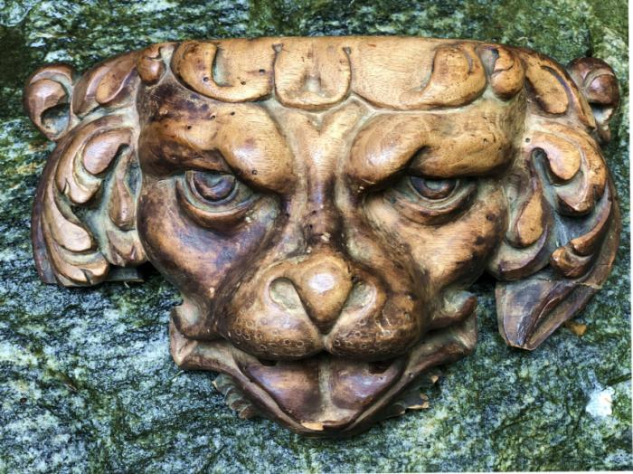 Baroque wood carving of a dog head
