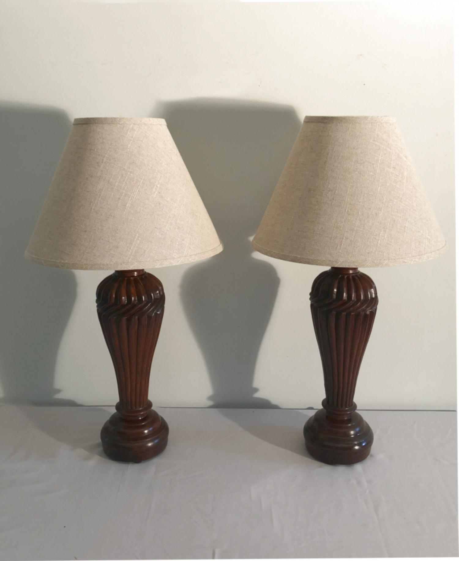 Pair of carved Indian padouk wood lamps