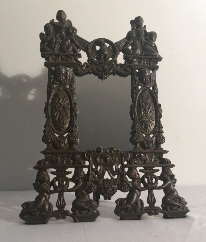 Antique Centennial commemorative cast iron dresser mirror