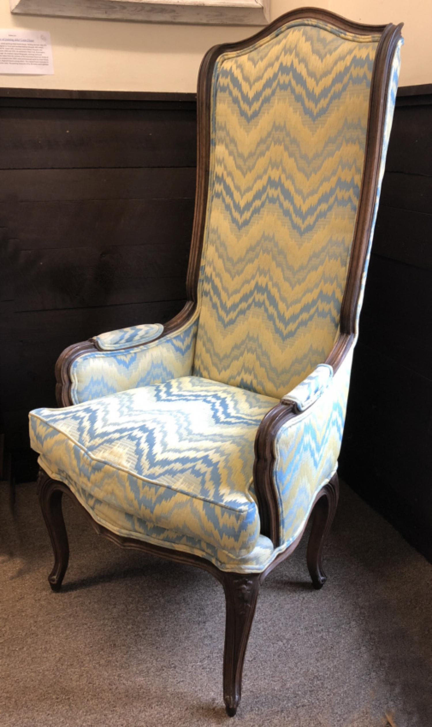 Vintage French tall back walnut wing chair