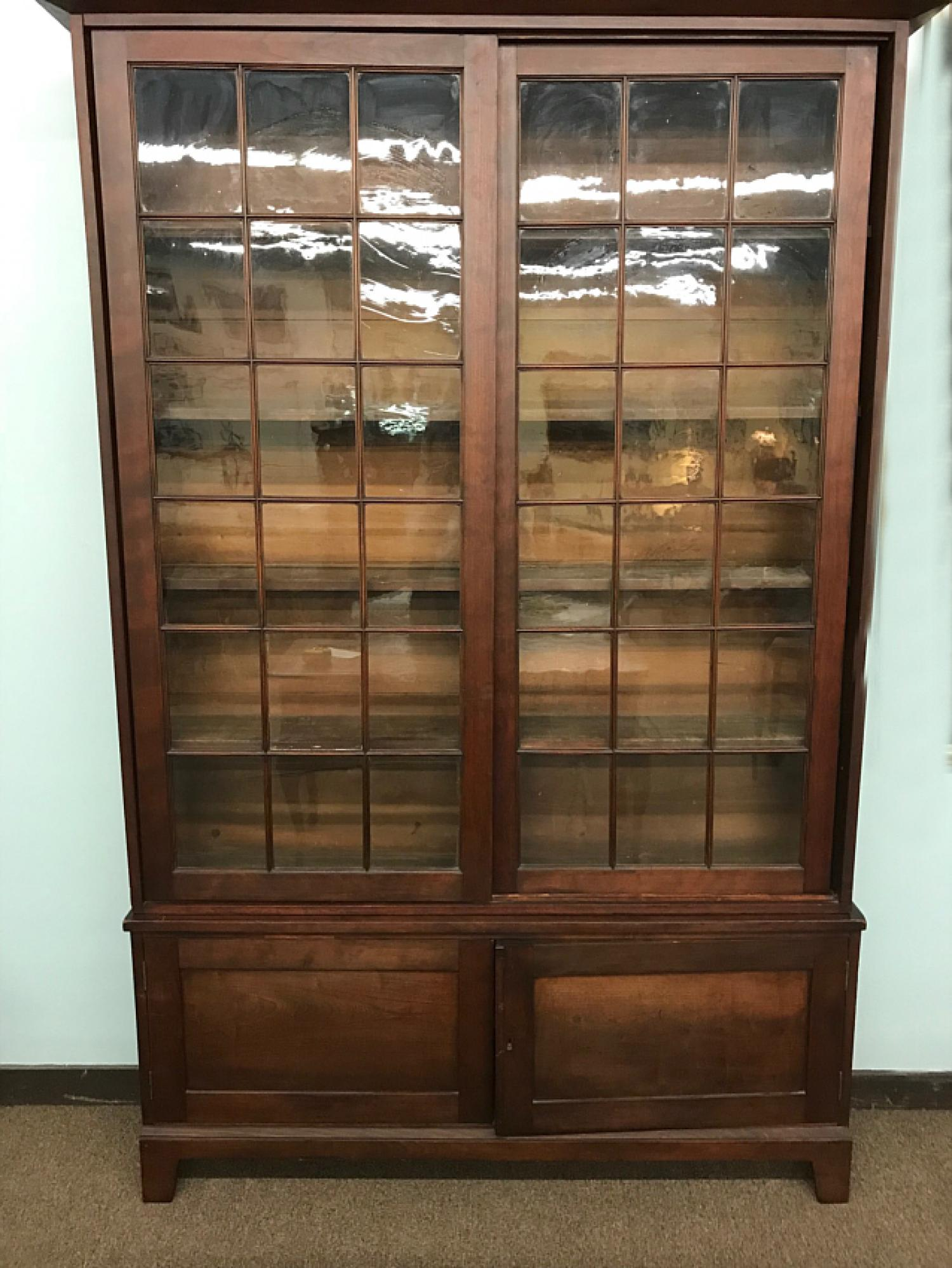 American cherry bookcase with sliding doors c1830