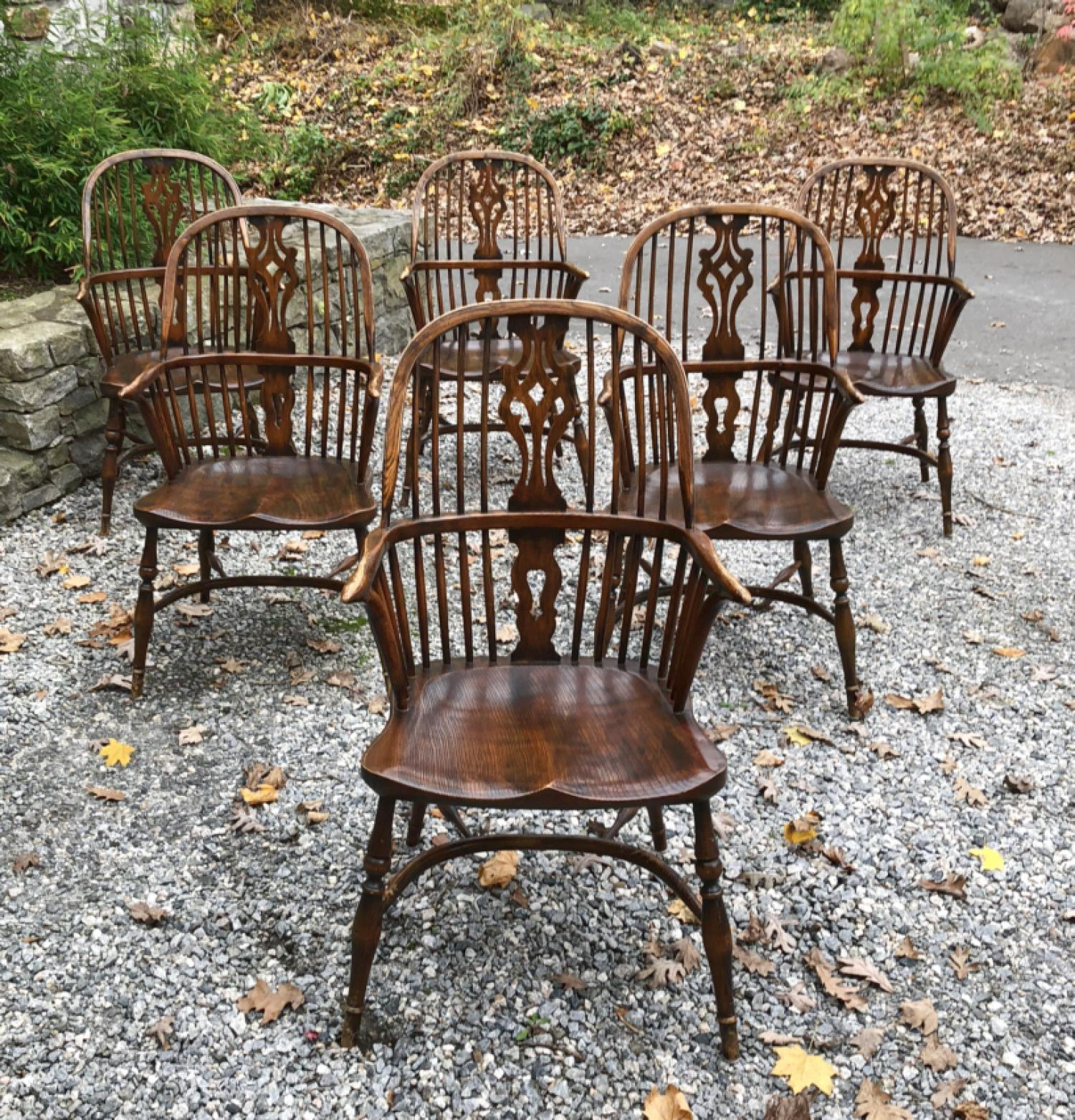 English elm Windsor arm chairs with saddle seats