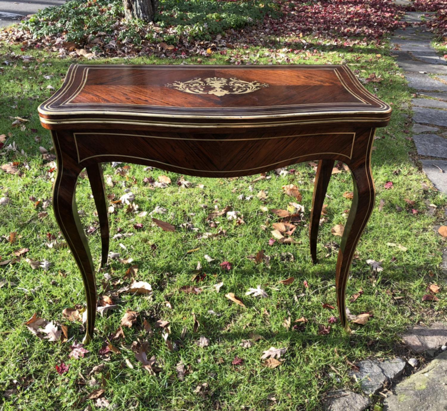 French Art Nouveau rosewood game table with brass inlay
