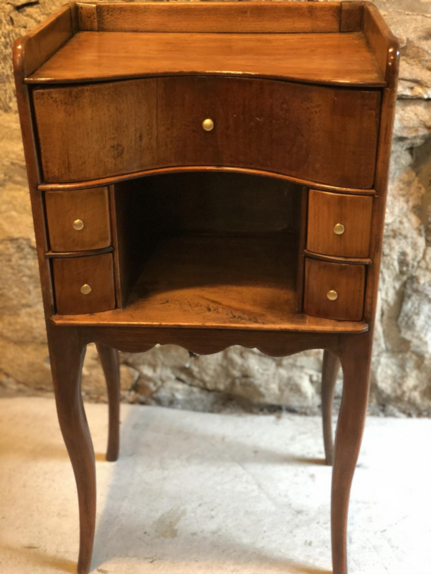 Early 19th century French walnut night stand with multiple drawers