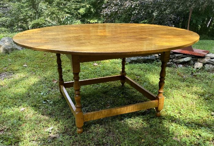 Tiger maple round dining table by J L Treharn
