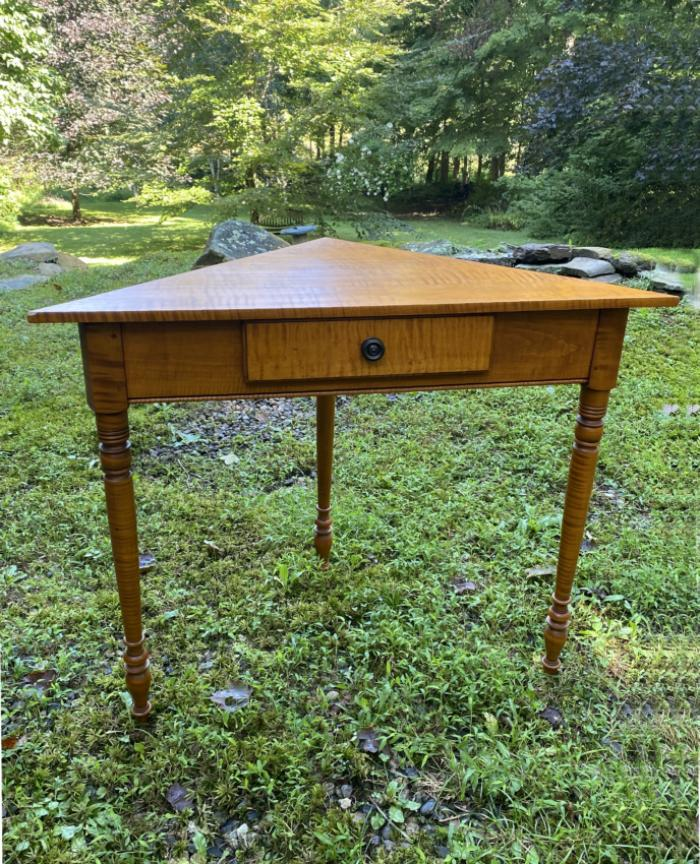 Rare Eldred Wheeler tiger maple corner table with drawer