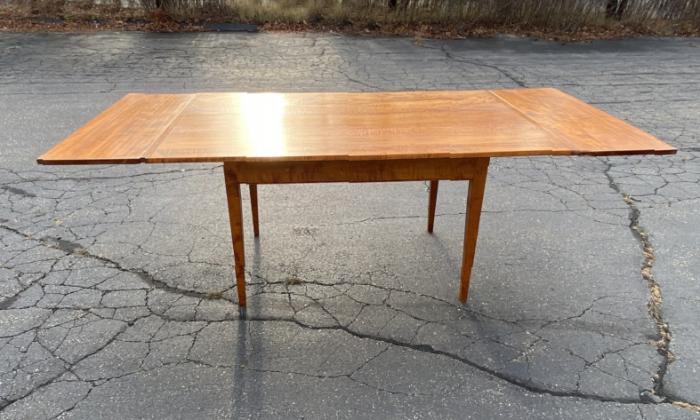 Tiger maple dining table by Threharn with two extra leaves