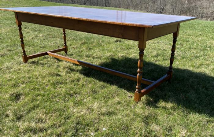 Large tiger maple dining table with trestle base