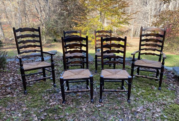 English oak chairs with wavy ladder backs and rush seats