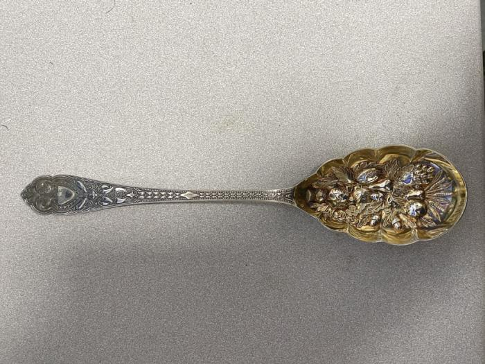 Sheffield silver serving spoon with gold vermeil