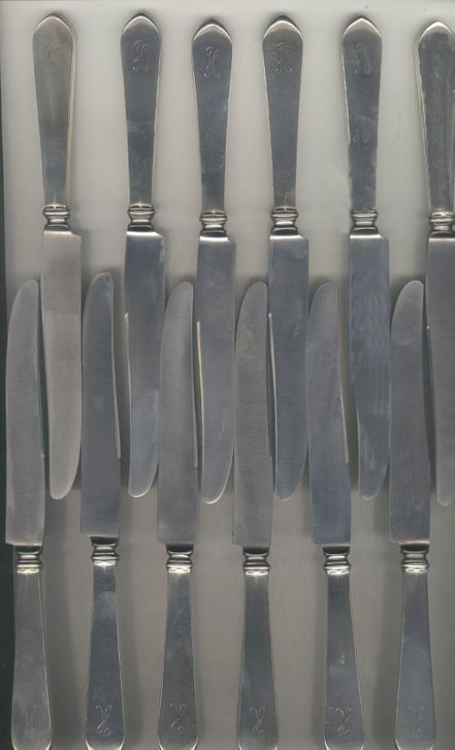 Set of twelve sterling silver knives pointed