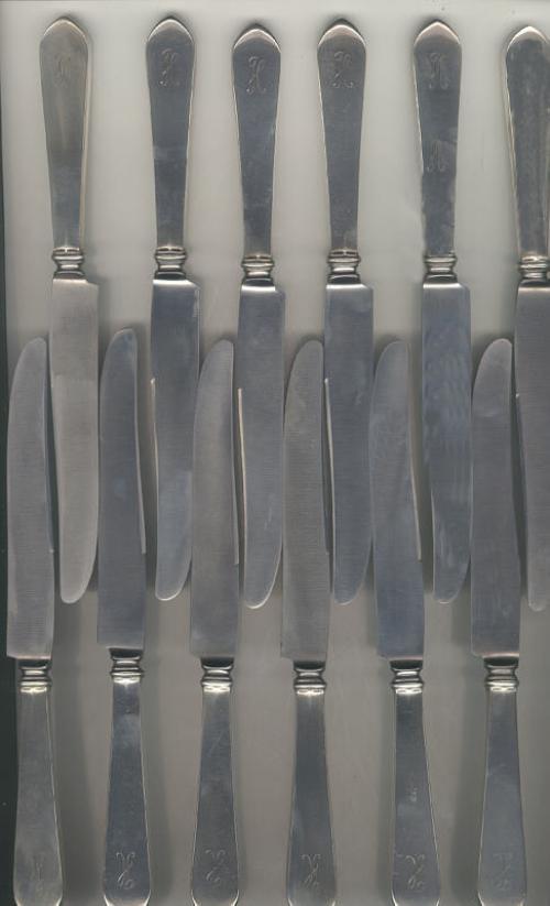 Set of twelve sterling silver knives pointed