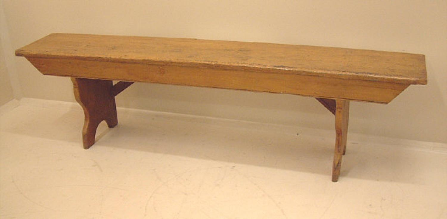 Early American painted country bench in mustard color