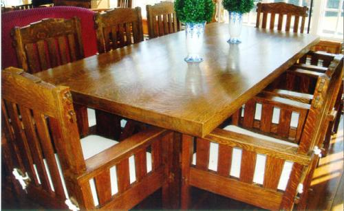 Mission oak table and ten matching chairs c1900