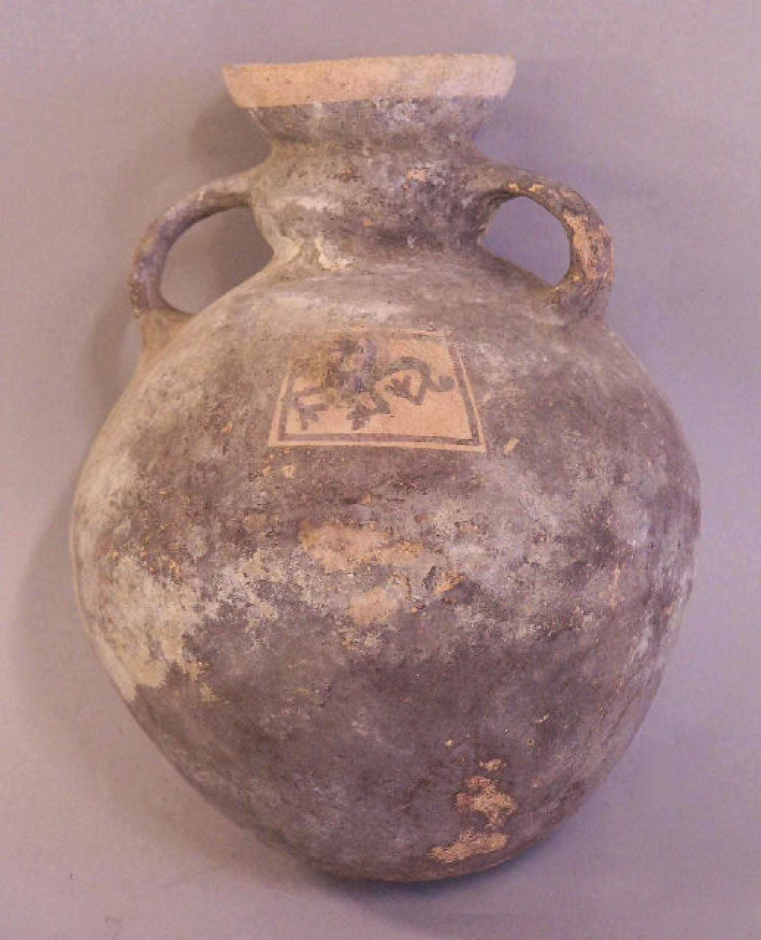 Pre Columbian pottery storage vessel with cougar