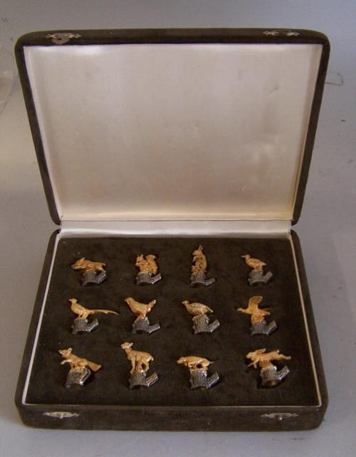 Boxed set of gold and silver animal place card holders c1900