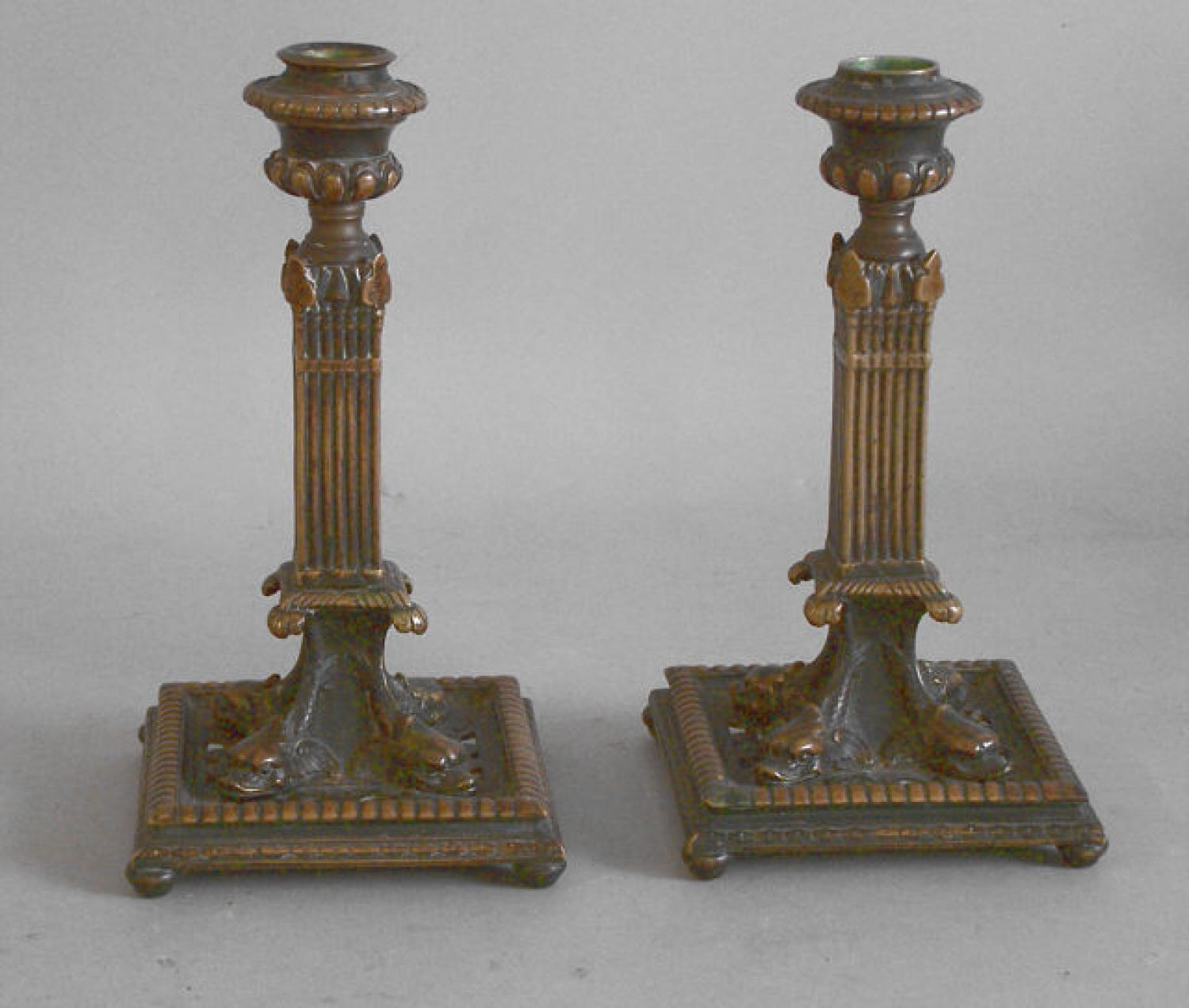 Pair brass column dolphin candlesticks