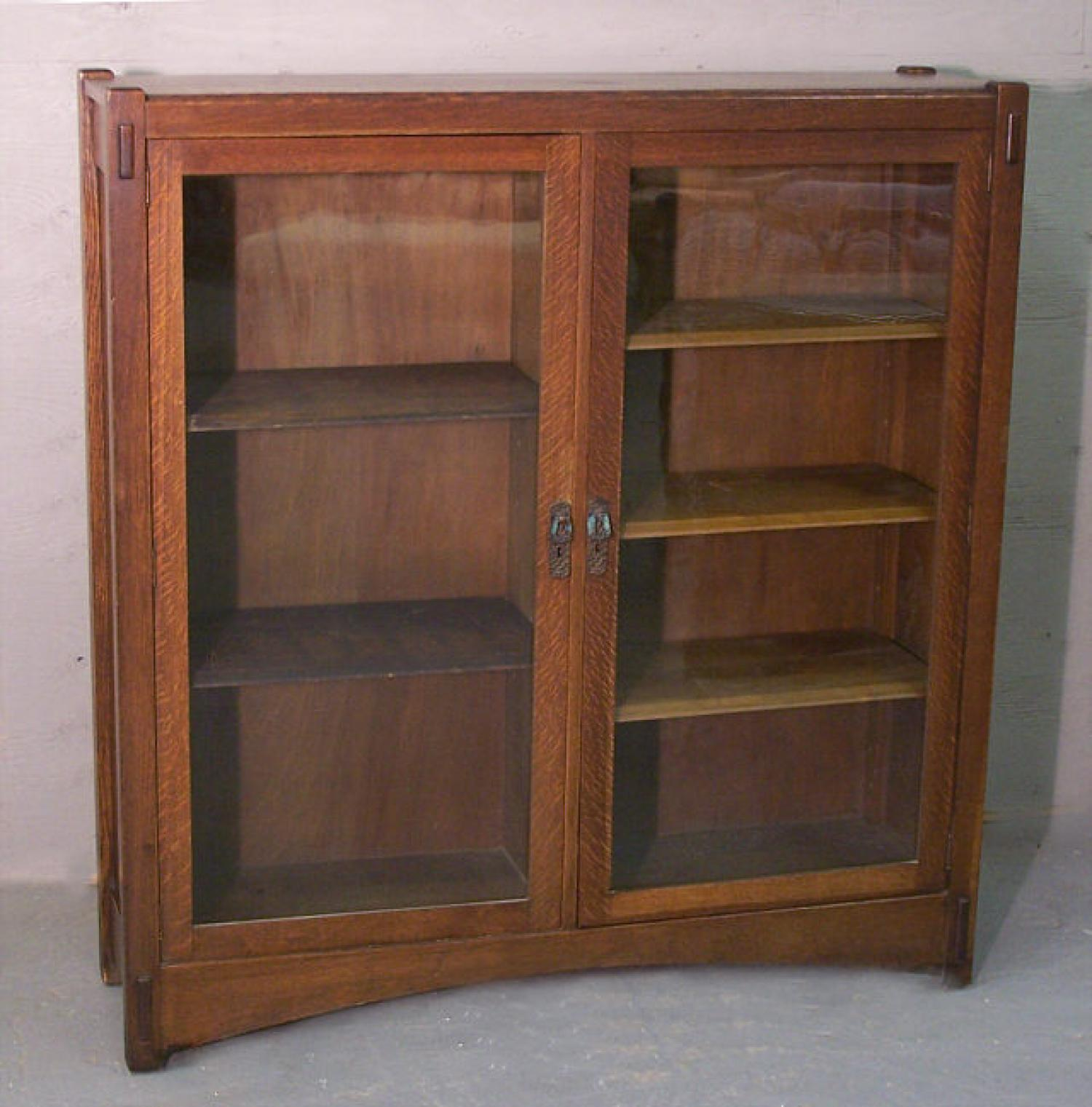 Paine Arts and Crafts quarter sewn oak double door bookcase