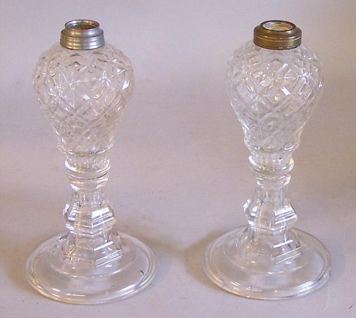 Pair glass oil lamps in diamond pattern on candlestick bases