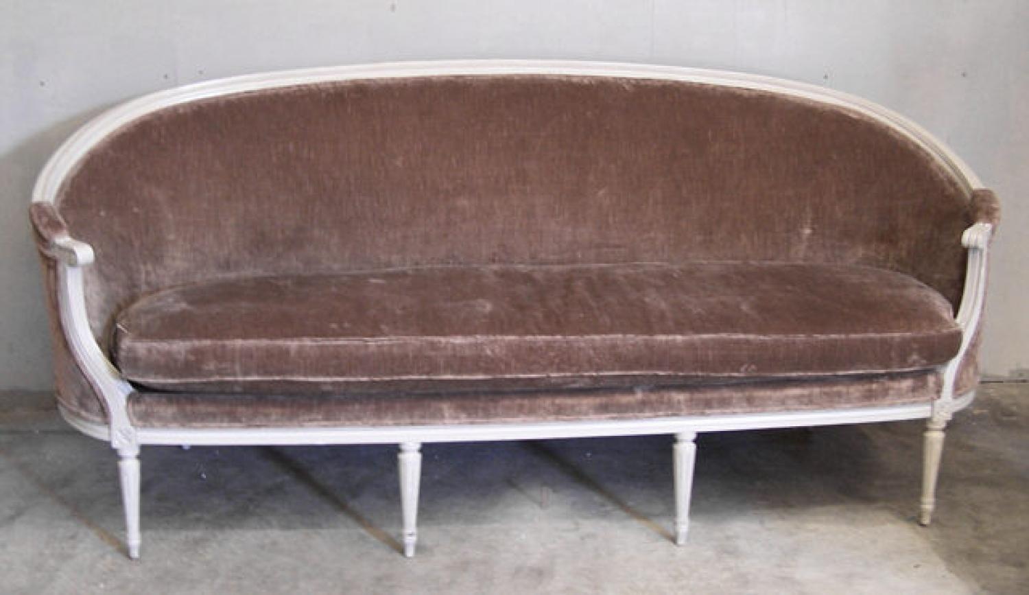 French upholstered canape with original paint carved arms