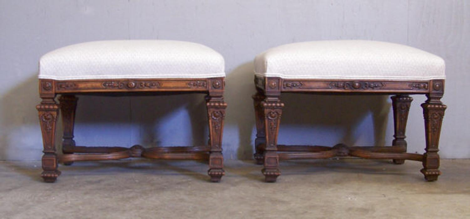 Pair continental carved walnut matching ottomans c1880