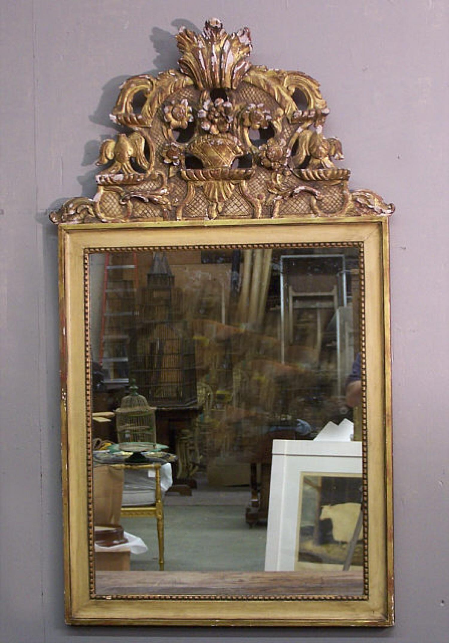 18th c gilt wood crest on later mirror frame