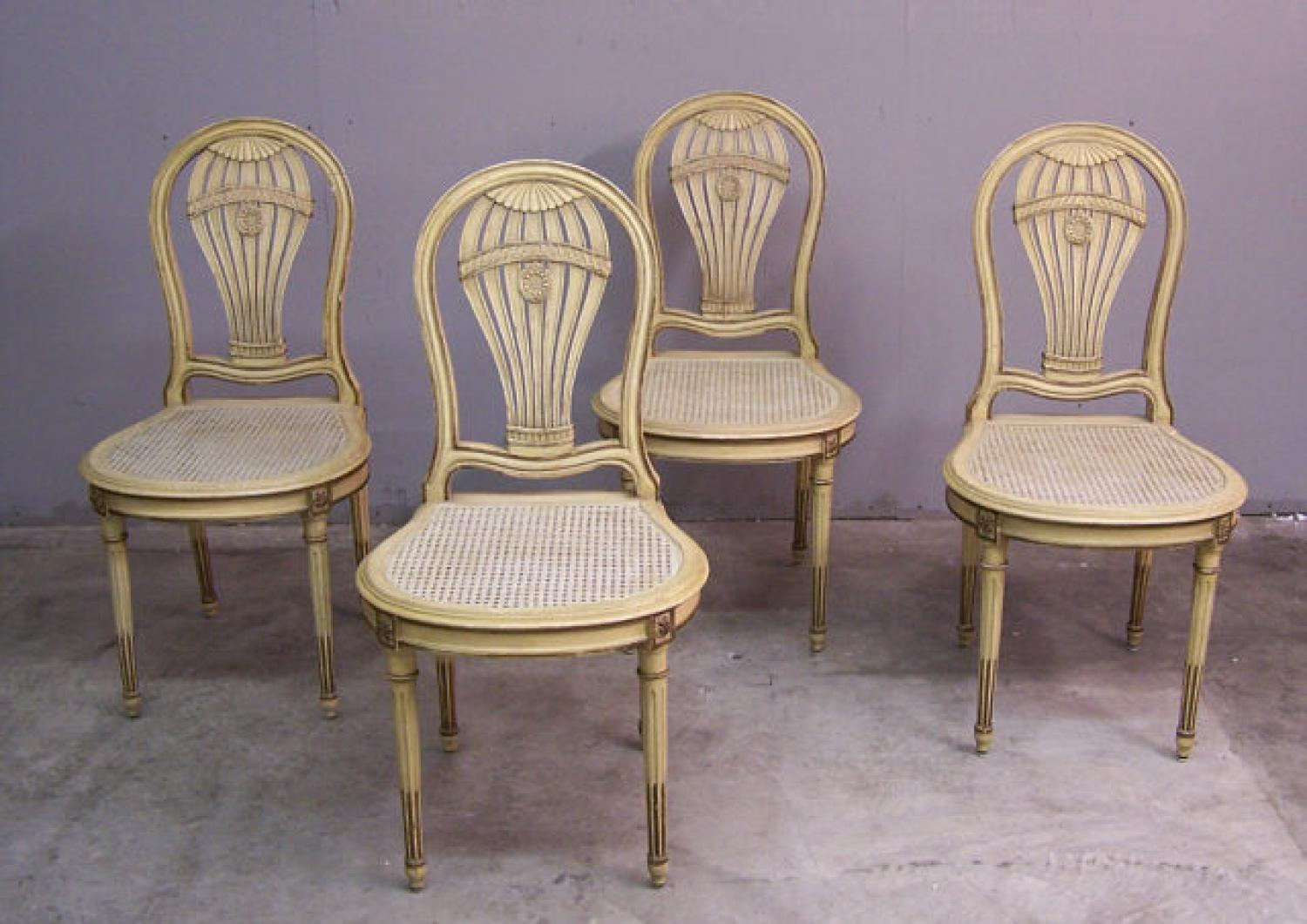 Set of four balloon back cane seat chairs c1900