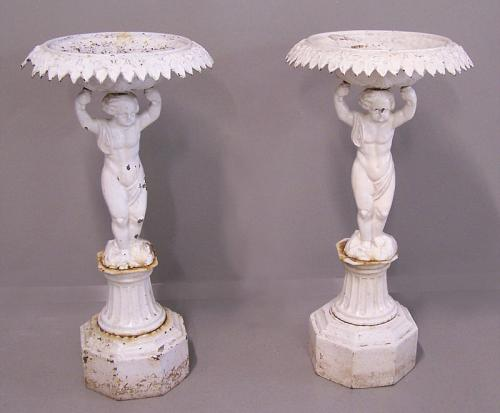 Pair of 19th c cast iron planter urns with cherub bases,