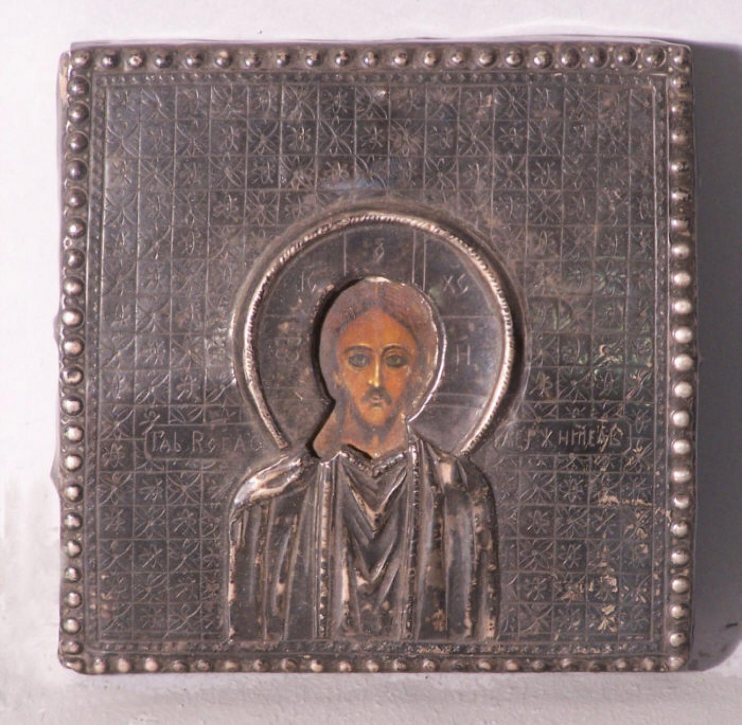 Small Russian Icon with silver cover 18th to early 19th century