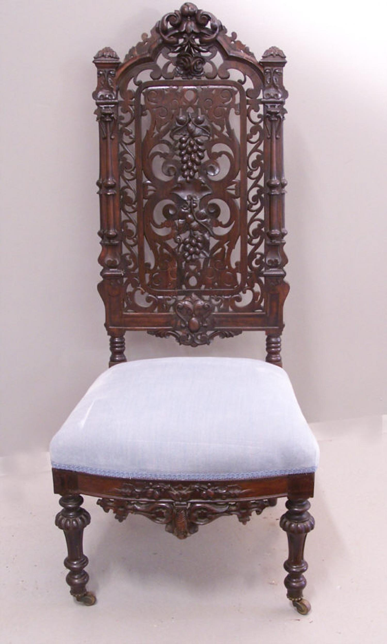 Victorian Gothic rosewood hand carved slipper chair c1850