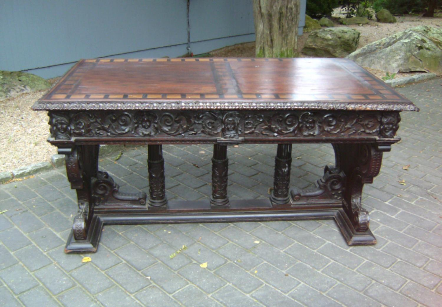 Renaissance style continental walnut library table 1800 to 1850