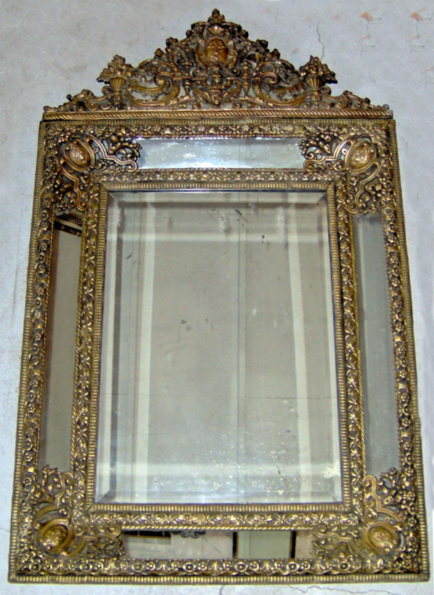 Continental 19th C repousse brass panelled mirror