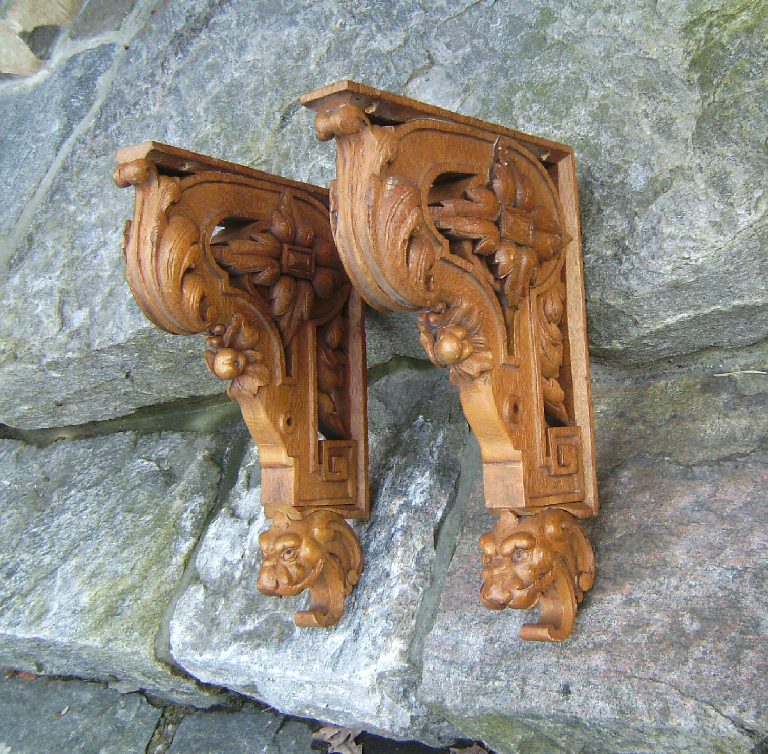Pair of carved oak shelf brackets with griffins c1880