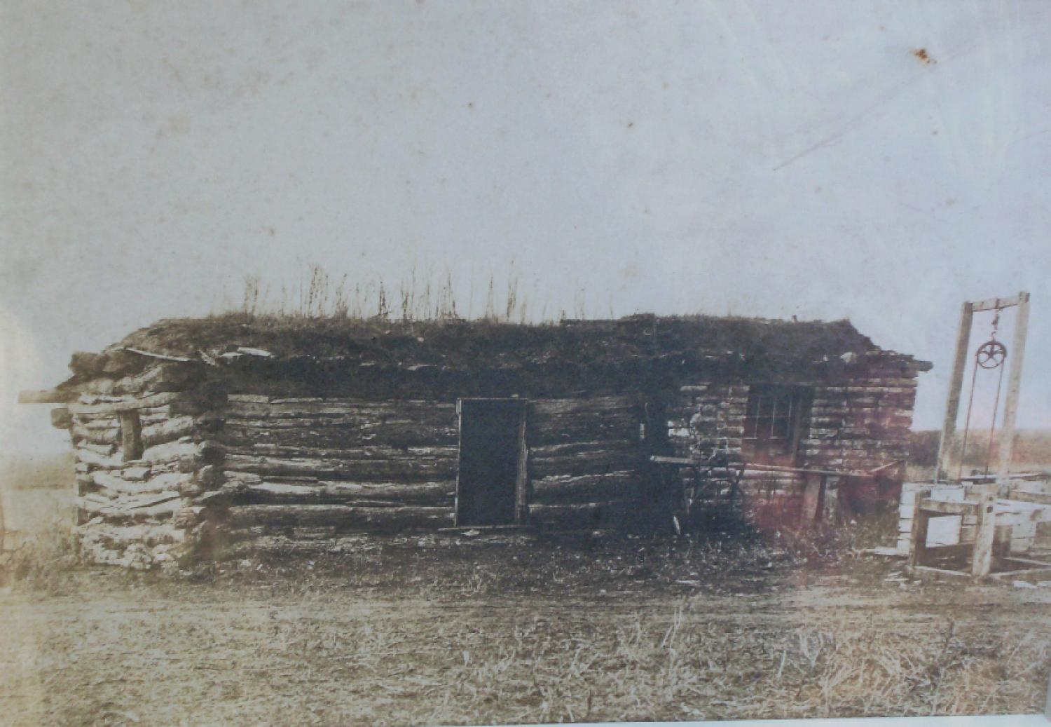 19th century photograph of log cabin