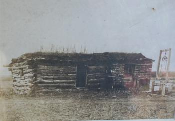 Image of 19th century photograph of log cabin