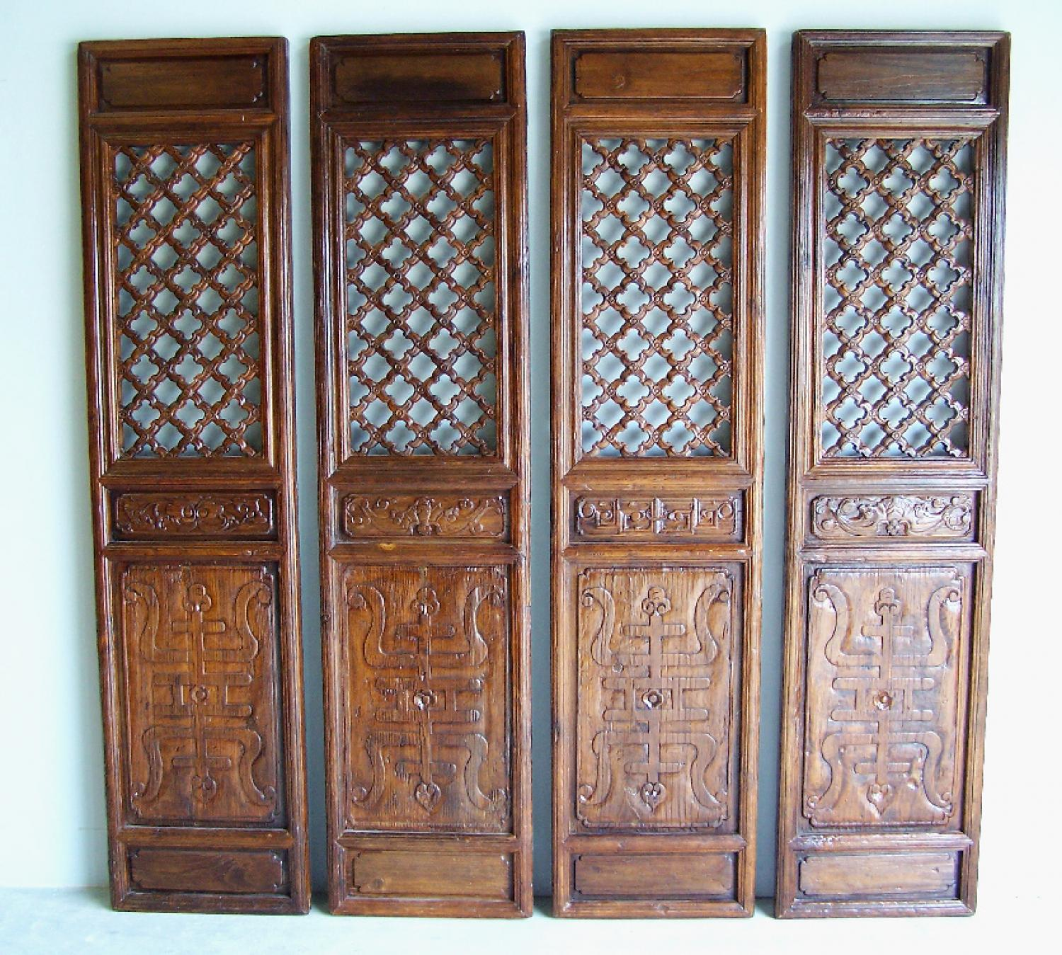 Set of four Chinese carved wood doors with open carving c1700
