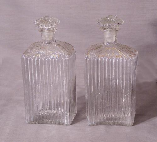 Pair of early blown glass liquor decanters c 1750