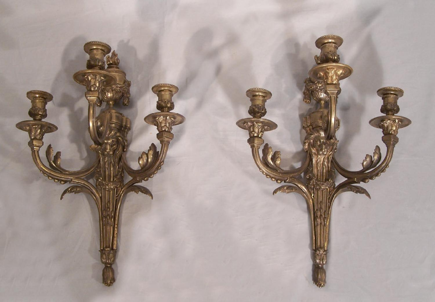 Pair silvered bronze candle sconces with lion masks
