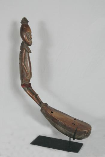 Image of African bow harp with female figure