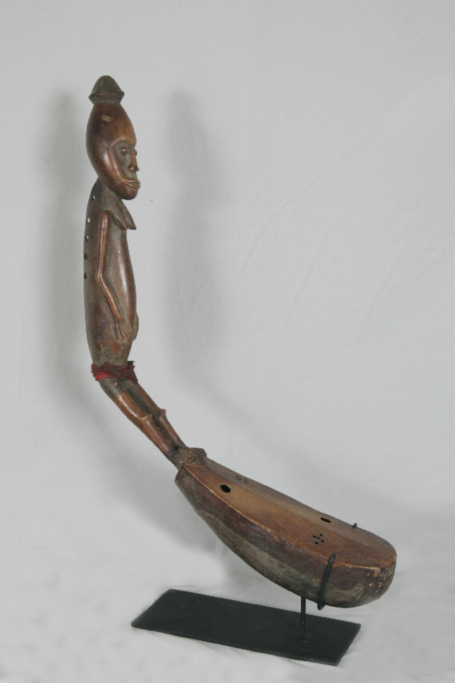 African bow harp with female figure