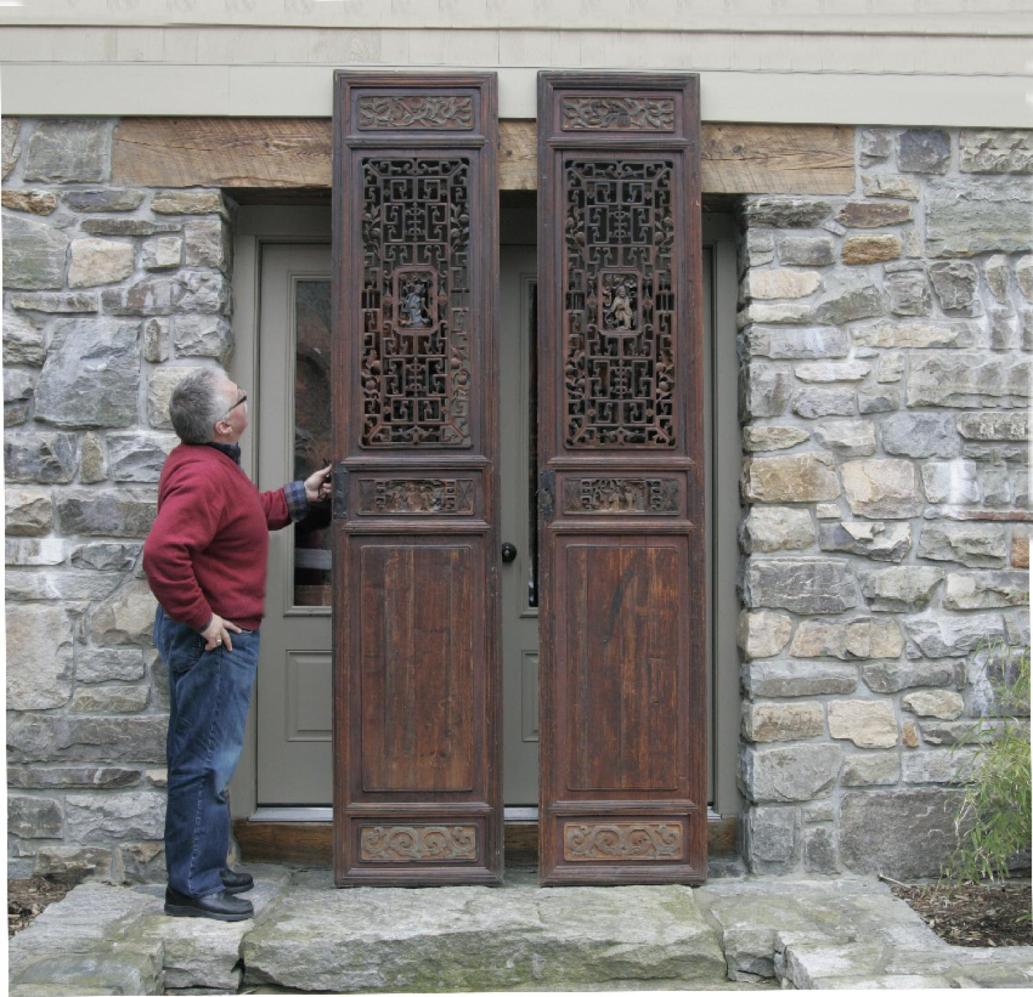 Pair of Chinese hand carved wood temple doors c1700