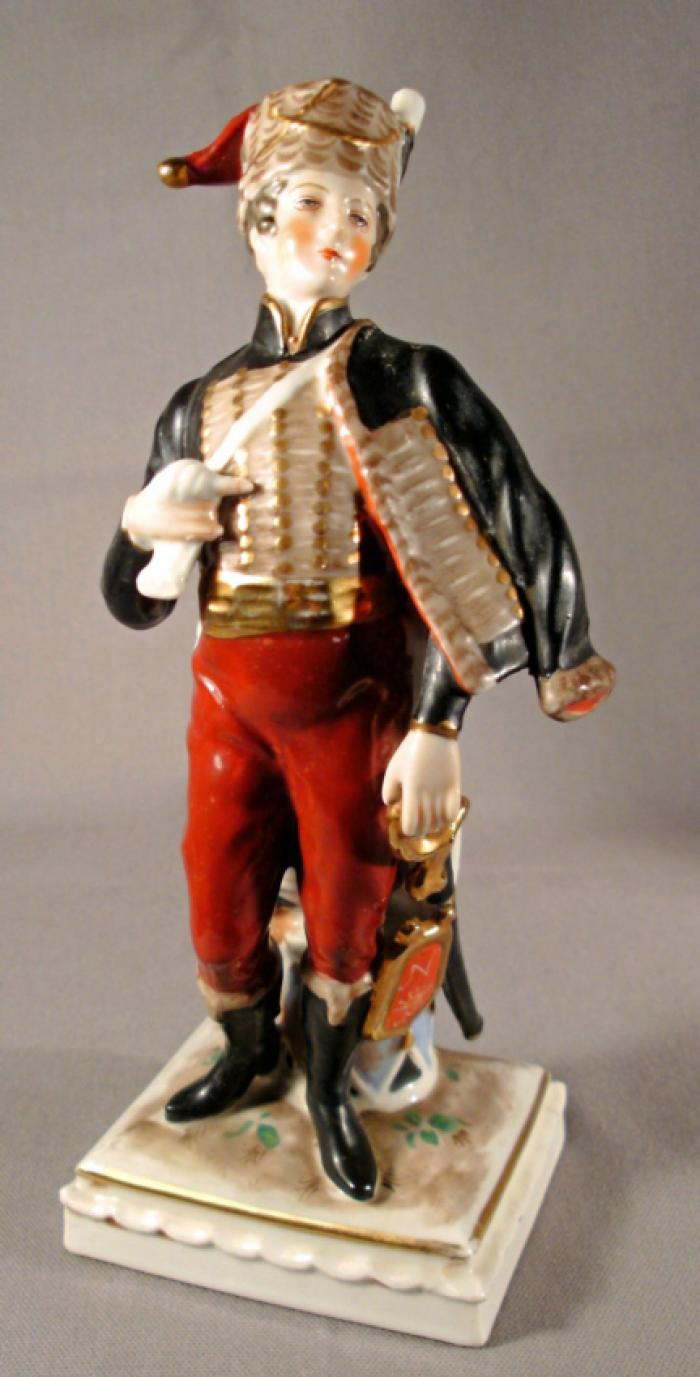 Handpainted porcelain standing figure of a Prussian soldier  c1870