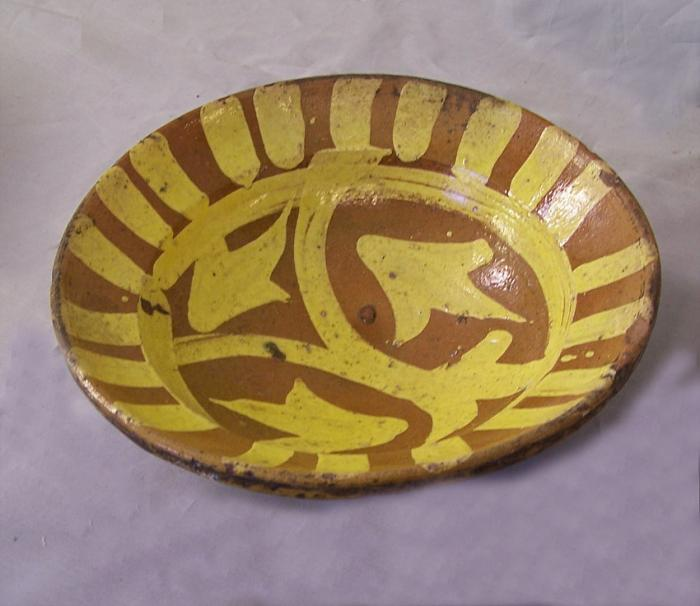 19th century Hunza clay pottery bowl with yellow slip design