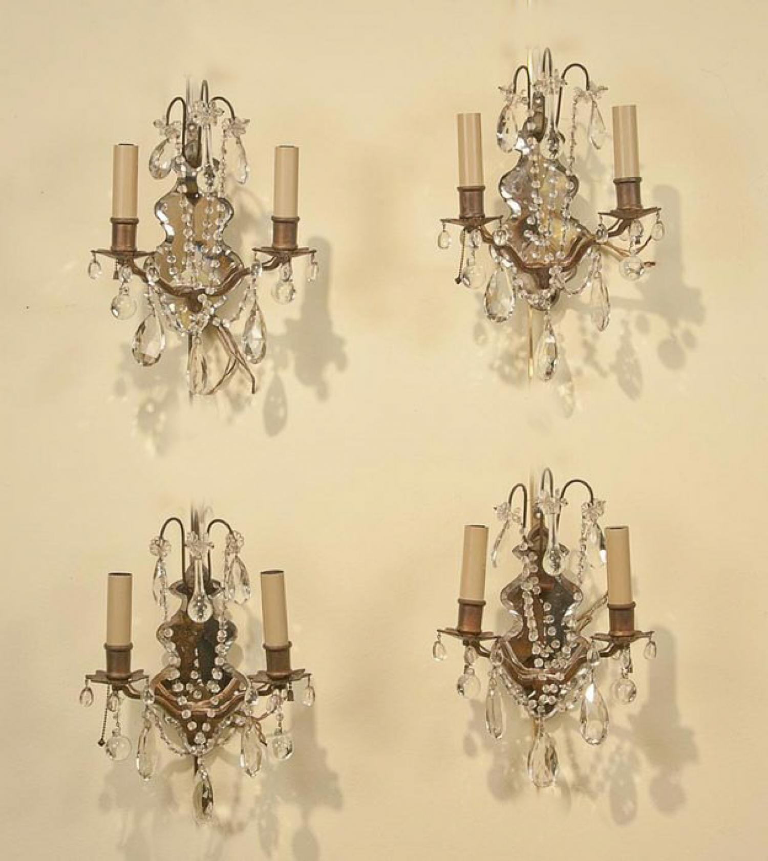 Set of four Regency style two light wall sconces with mirrors
