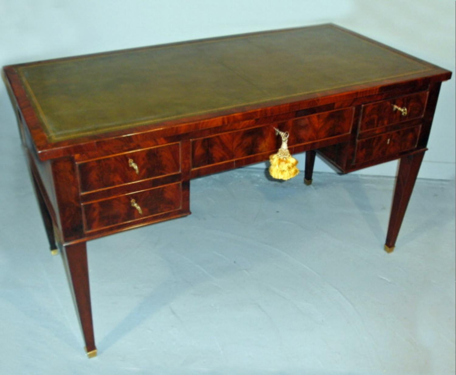 Louis XVI period flame mahogany bureau plat or writing desk c1790
