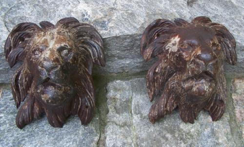 Pair 19th c cast iron architectural lion masks