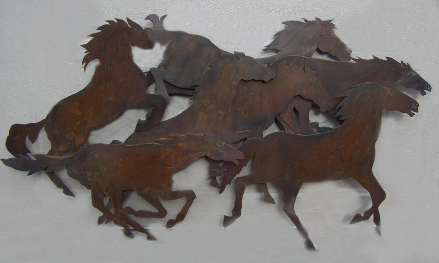 Galloping horses wall sculpture